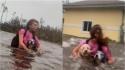 Jovem faz o possível e o impossível para segurar seus cães durante passagem de furacão. (Foto: Tim Aylen)