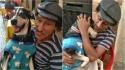 Cadela de morador de rua faz sucesso nas redes ao fingir dormir quando o dono canta música de ninar. (Foto: Reprodução Facebook/Edna Frigato)