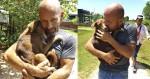 Cadela presa em matadouro se recusa a deixar homem que a salvou para trás