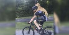 Homem dá carona de bike a cão que fraturou perna na estrada
