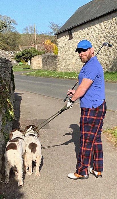 Jogador de golfe.