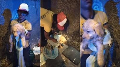 Jovem sem-teto abre mão de única marmita de comida para alimentar filhote que resgatou. (Foto: Facebook/Gabriela RedheaPerea)