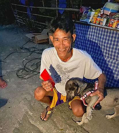 O cachorro Blacky com seu dono.