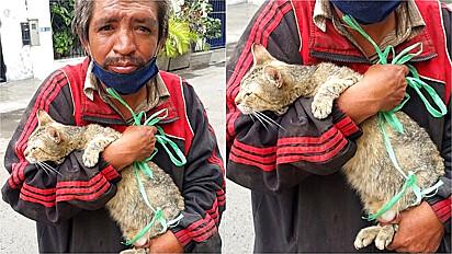 Família pede para morador de rua se desfazer de gato e ele se nega a tomar tal atitude.